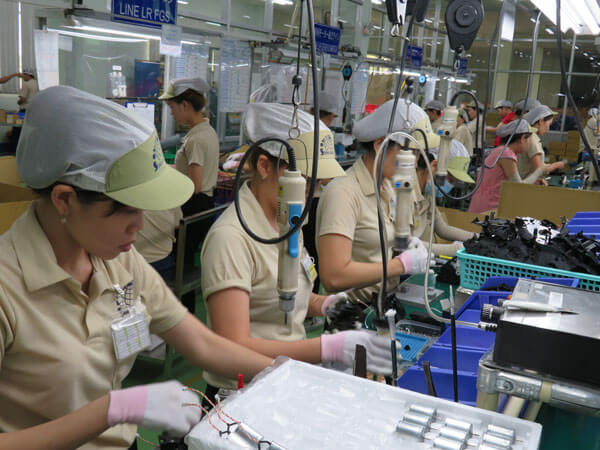 A factory in Vietnam an its local staff